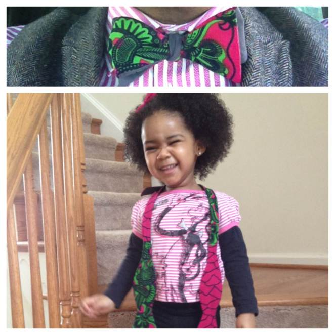 How cute is she!?!?Reversible pink and green African wax print bow tie with dark grey on the back.
