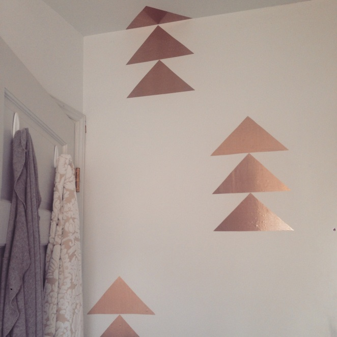 Copper contact paper on bathroom wall